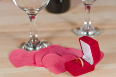 Ring in the box on  heap of paper hearts Royalty Free Stock Photos
