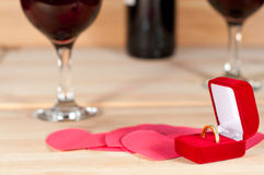 Ring in the box on  heap of paper hearts Stock Image