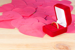 Ring in the box on  heap of paper hearts Stock Photo