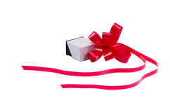 Ring box with red ribbon. White engagement ring box with red ribbon royalty free stock photos