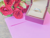 Ring box and rose with envelope Stock Image