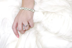 Ring of Bride Against Her Dress With Copy Space Stock Photos
