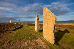 Ring of Brodgar, Orkney, Scotland. The Ring of Brodgar, Orkney, Scotland is a megalithic stone circle henge monument built during the Neolithic era and is the Stock Photography