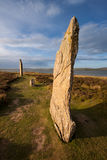 Ring of Brodgar, Orkney, Scotland. The Ring of Brodgar, Orkney, Scotland is a megalithic stone circle henge monument built during the Neolithic era and is the Royalty Free Stock Photo
