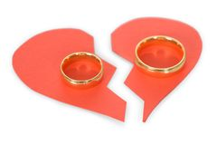 Ring on broken heart. Golden Ring On Red Broken Heart Over White Background Royalty Free Stock Images