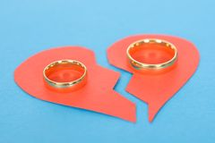 Ring with broken heart. Over Blue Background Royalty Free Stock Photo