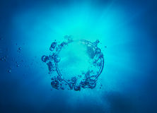 Ring and bubbles from air in water Stock Images