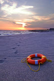 Ring buoy. Lying on the sandy beach Stock Photography