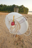Ring Buoy on a Beach. A rescue ring buoy on the beach of a lake stock photo