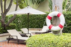 Ring buoy beside the sun bed Royalty Free Stock Photos