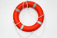 Ring buoy on a white wall Royalty Free Stock Images