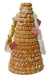 Ring Cake with Crackers. Traditional Norwegian marzipan ring cake - kransekake - seen from side with crackers and Norwegian flags. Isolated with clipping path Royalty Free Stock Photo