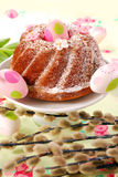Ring cake on easter table. Traditional ring cake with icing sugar on easter table decorated with catkins Stock Images