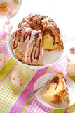 Ring cake with icing and chocolate glaze on easter table Royalty Free Stock Image