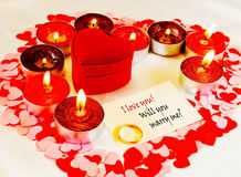 Ring and a card with marriage proposal Royalty Free Stock Photos