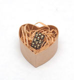 Ring in cardboard box in the form of heart Royalty Free Stock Images