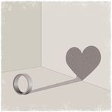 Ring cating shadow of heart shape Royalty Free Stock Photography