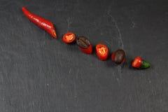 Ring Chili-Pfeffer und -kaffee Stockfotos