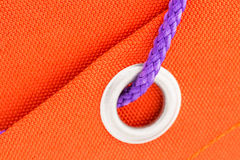 Ring and cord on orange fabric macro Royalty Free Stock Photos