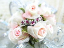 Ring on Corsage. A ring with band of alternating diamond and ruby placed on a corsage royalty free stock photo
