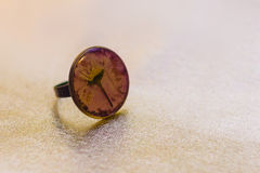 Ring with crystal made of epoxy resin and flower Royalty Free Stock Image