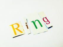 Ring - Cutout Words Collage Of Mixed Magazine Letters with White Background. Caption composed with letters torn from magazines with White Background Royalty Free Stock Photos