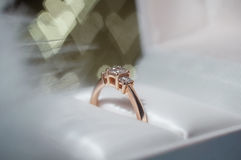 Ring with diamond in a box against the background of hearts. Valentine`s Day Stock Photography