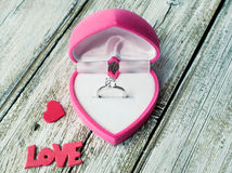 Ring with diamond in heart shaped box Stock Photos