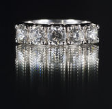Ring with diamonds. On black background Royalty Free Stock Image