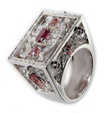 Ring with Diamonds and Rubies. Platinum Ring with Diamonds and Rubies on white background Royalty Free Stock Images