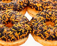 Ring doughnuts. A closeup of  ring donuts with Halloween sprinkles Royalty Free Stock Photos