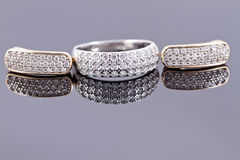 Ring and earrings Stock Images