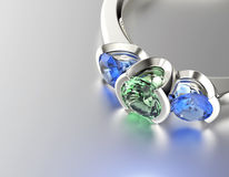 Ring with Emerald. Jewelry background Royalty Free Stock Photography