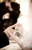 Ring exchange. Bride and groom exanging rings Soft focus stock photos