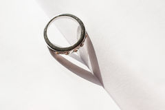 Ring falling shadow in the shape of heart Royalty Free Stock Images