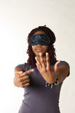 Ring finger. Blindfolded African American woman pointing to her bare ring finger Stock Photo