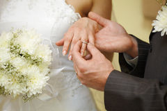 Ring on finger bride close-up Royalty Free Stock Photo