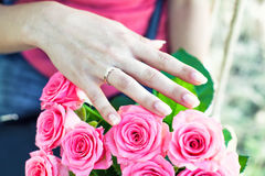 Ring on a finger Stock Photos