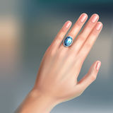 Ring on finger. Vector human hand with silver brilliant ring on finger  on background Stock Photo