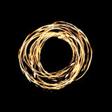 Ring of Fire. A hot circle of firey flames on a black background created by a fire dancer Stock Images