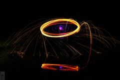 The Ring of Fire. Amazing long exposure picture taken with a cannon camera on a beach in lake Michigan using fire and led lights royalty free stock photo