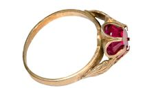 Ring with garnet. Old silver ring covered by gold with garnet royalty free stock photography