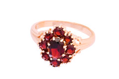 Ring with garnets. Closeup of the ring with garnets on white background royalty free stock images