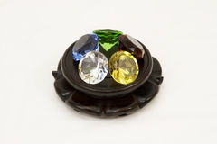 Ring of gems. A ring of gems resting on a rosewood pedestal royalty free stock image