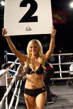 Ring Girl Amateur and Professional Boxing. Ring girl holds up round number sign. Amateur male amateur and professional boxers fight in Phoenix, Arizona, USA, at royalty free stock images