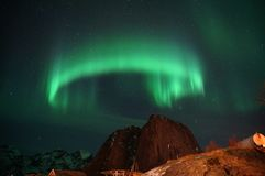 Ring green shaped northern light on dark sky in Norway stock photo