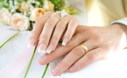 Ring & hands over white and flowers Royalty Free Stock Images