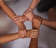 Ring hands sign of teamwork stacked together royalty free stock photography