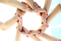 Ring of hands teamwork showing Stock Photo