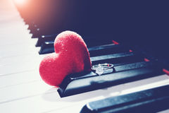 Ring and hearts on piano ,vintage tone. Valentines Day background Stock Photo